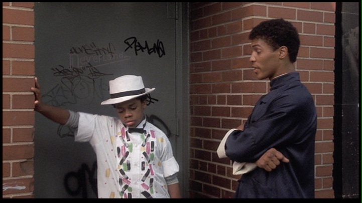 Leo OBrien and Taimak outside 7th Heaven in The Last Dragon