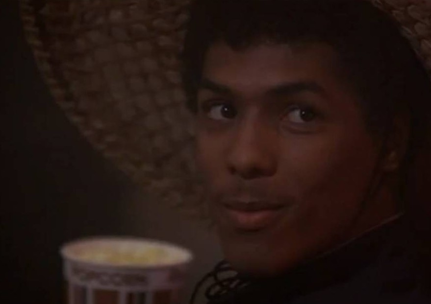 Bruce Leroy at the movies eating popcorn with chopsticks