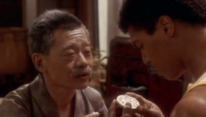 Leroy's Master Hands him Bruce Lee's Gold Charm Medallion